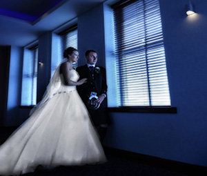 Married couple in a dark room