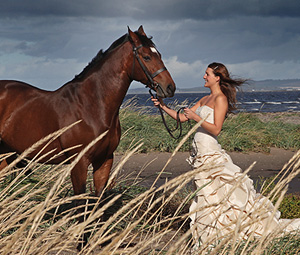 Woman in wedding dress with horse