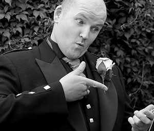 Male Wedding Guest pointing to pocket watch