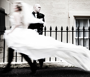 Bride rushing by standing groom